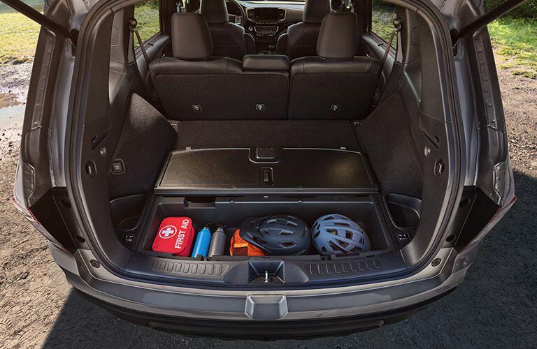 2019 Honda Passport interior shot with trunk up showing open underfloor cargo compartment