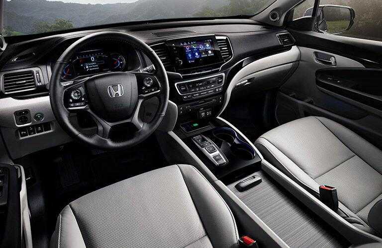 Front seats and steering wheel in the 2020 Honda Pilot EX-L