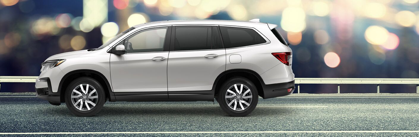 2020 Honda Pilot parked against a background with blurred lights
