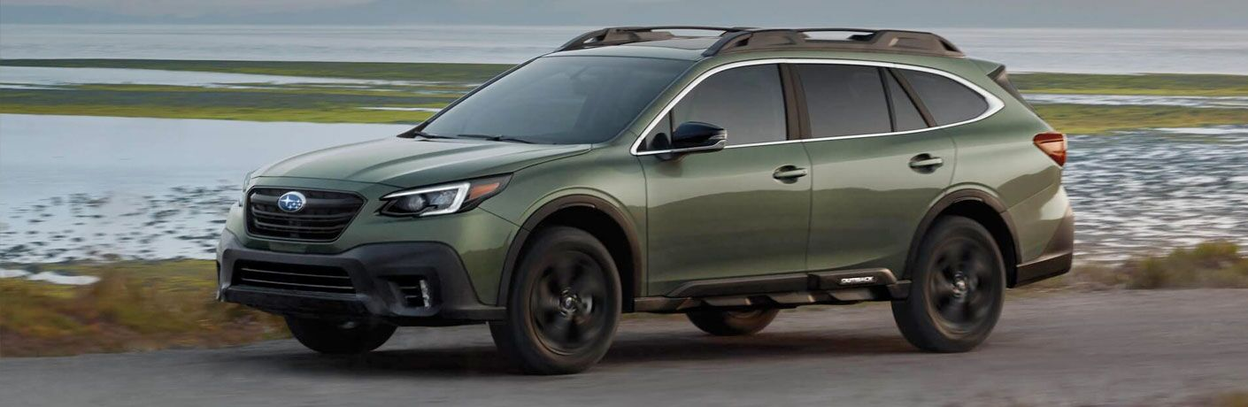 2020 Subaru Outback driving down a rural road