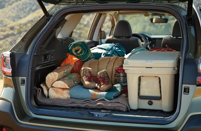 The cargo area of a 2020 Subaru Outback full of luggage and equipment