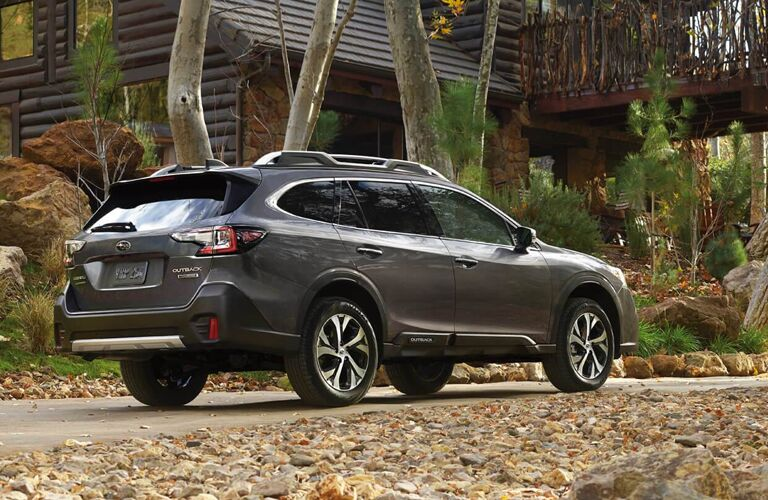2020 Subaru Outback parked on a rural trail