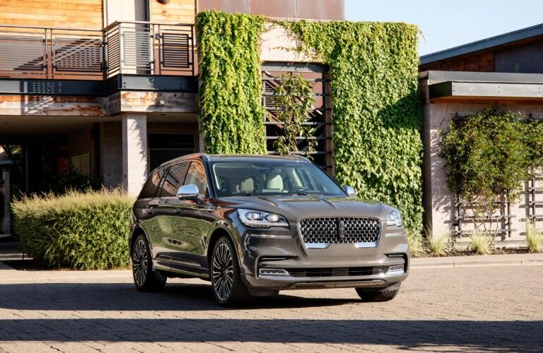 2020 Lincoln Aviator parked in front of a house