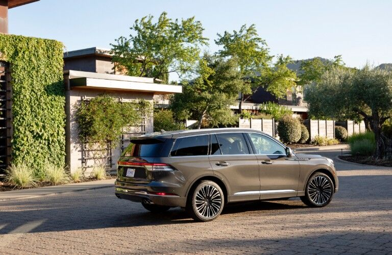 2020 Lincoln Aviator parked in front of a modern home