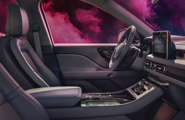 Cabin of the 2020 Lincoln Aviator with pink smoke outside the windows