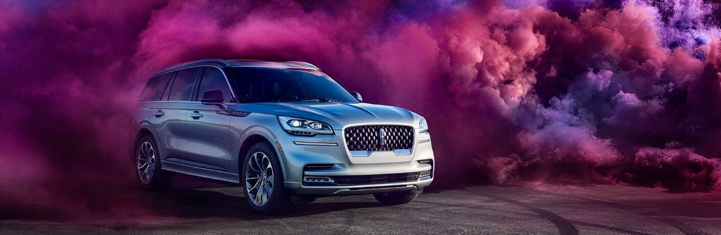 2020 Lincoln Aviator surrounded by pink smoke