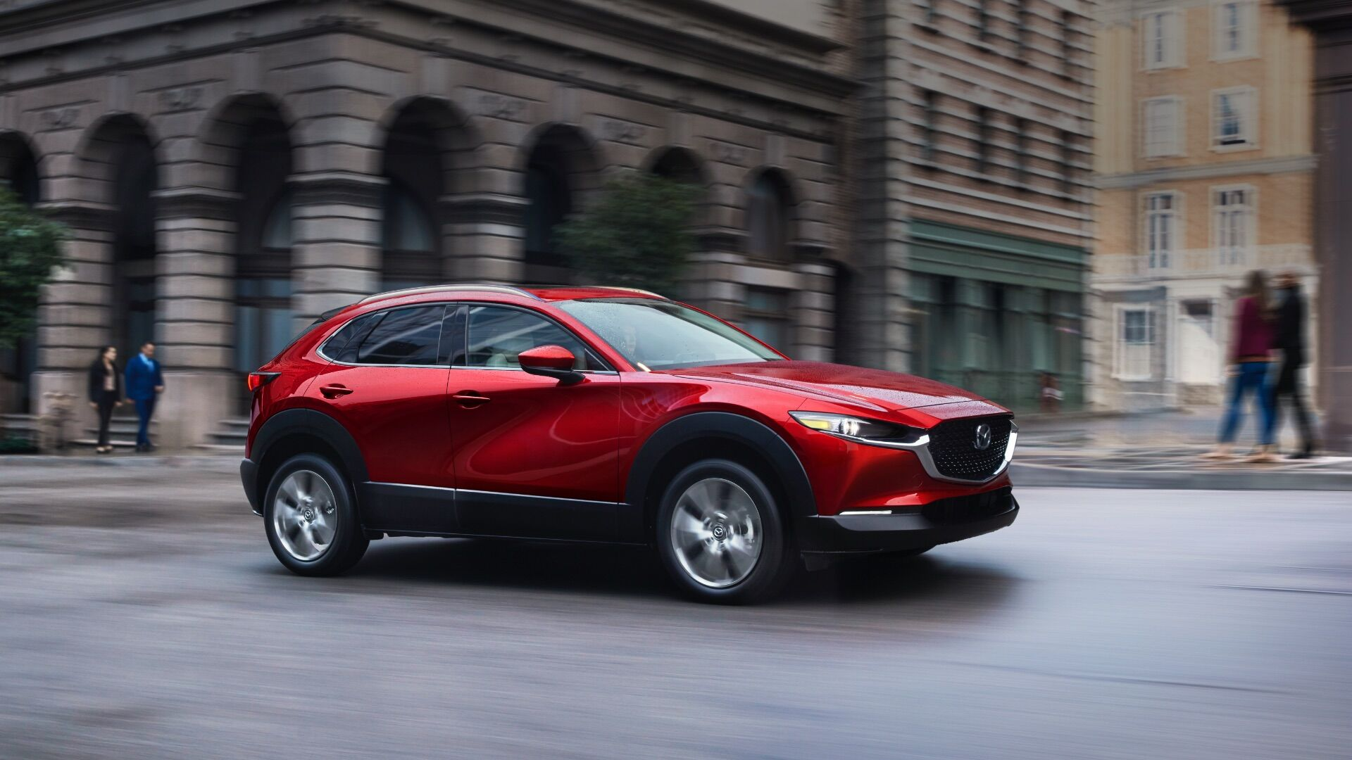 A 2020 mazdacx30 driving on a city street