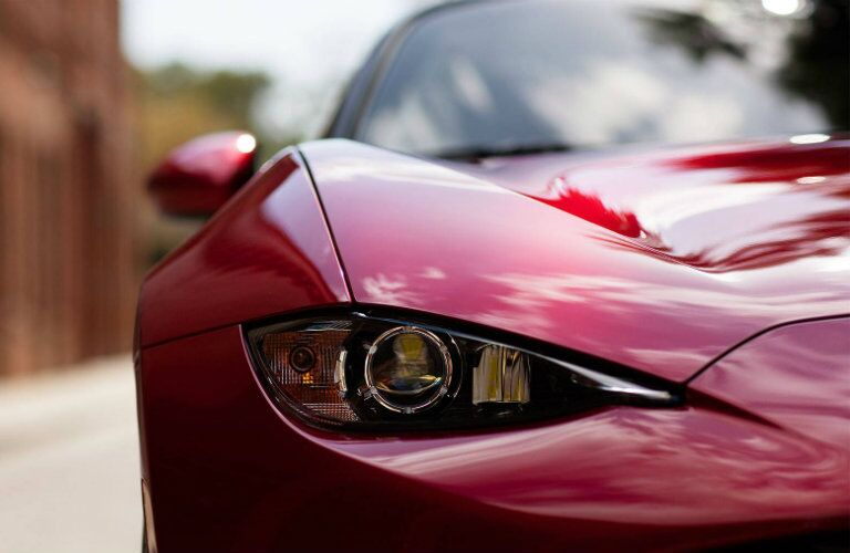 Headlight of Red 2018 Mazda MX-5 Miata RF