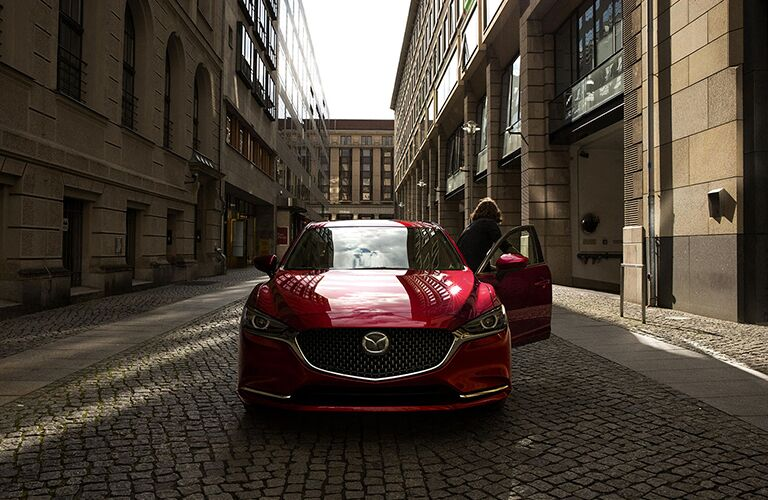 Woman Opening the Door of a Red 2018 Mazda6
