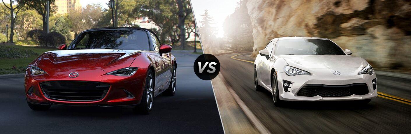 Red 2019 Mazda MX-5 Miata, VS icon, and white 2019 Toyota 86