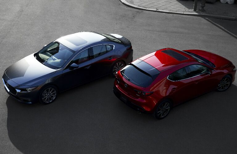 Overhead view of grey 2019 Mazda3 Sedan and red 2019 Mazda3 Hatchback