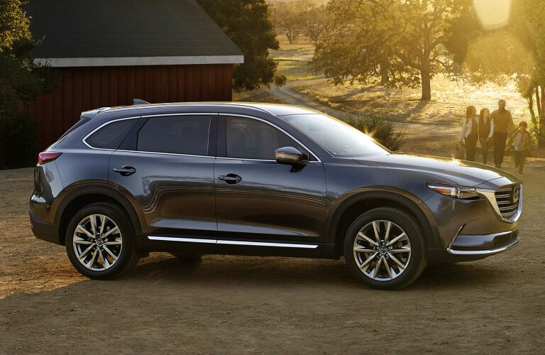 Dark Grey 2019 Mazda CX-9 Parked in Front of a Barn