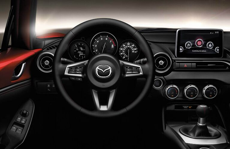 Steering wheel, gauges, and touchscreen in 2019 Mazda MX-5 Miata