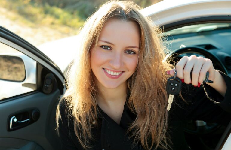 car owner showing keys to her used manual transmission car