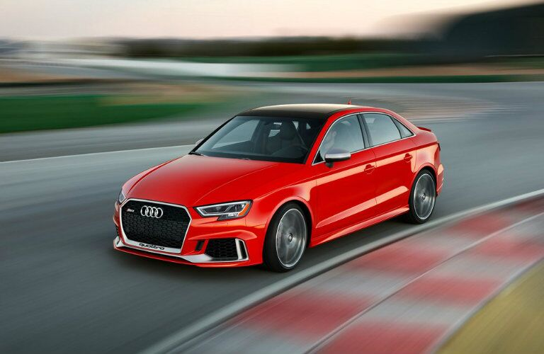 red Audi RS 3 driving on racetrack