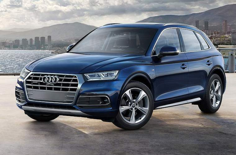 blue Audi Q5 by water