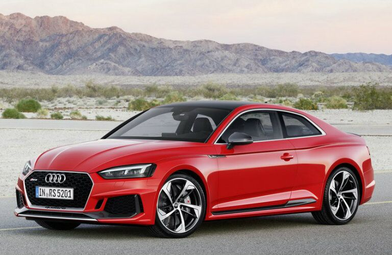 red Audi RS 5 parked in desert