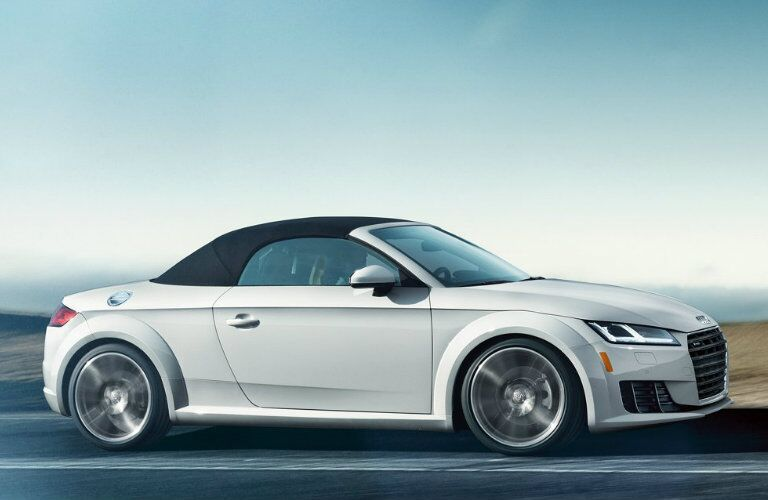 white Audi TT roadster driving on road