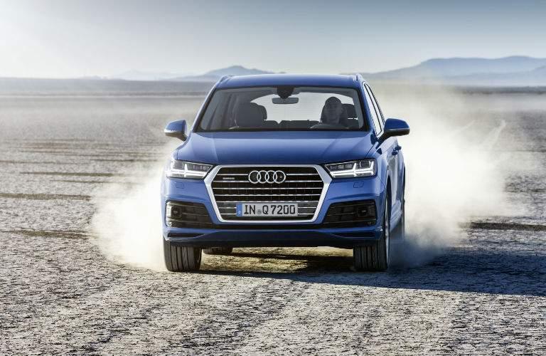 blue 2018 Audi Q7 driving