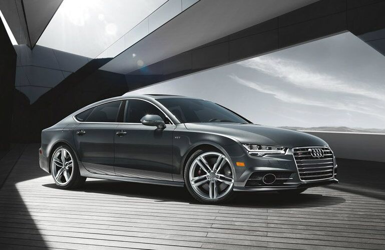 gray Audi S7 parked under modern structure