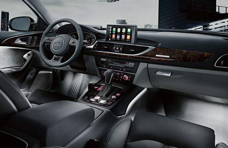 front interior of 2018 audi a6 shown with infotainment system dashboard and steering wheel