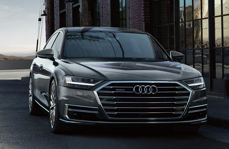 2019 Audi A8 exterior front shot parked outside a glass plated building