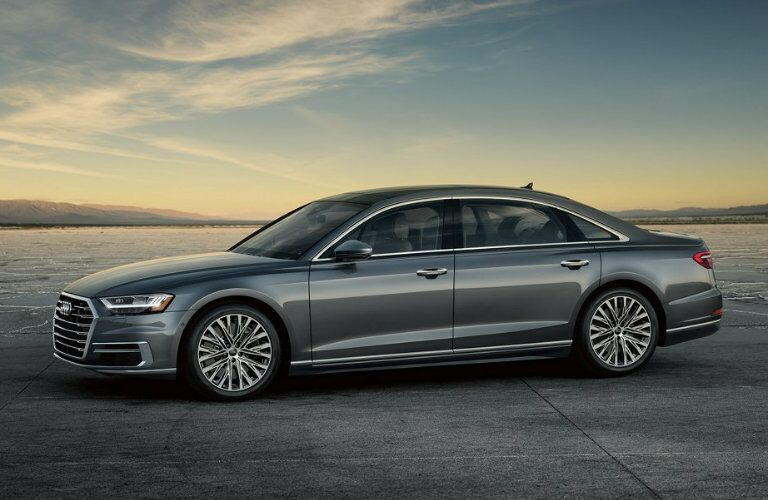 side profile of gray Audi A8 parked on wide open area