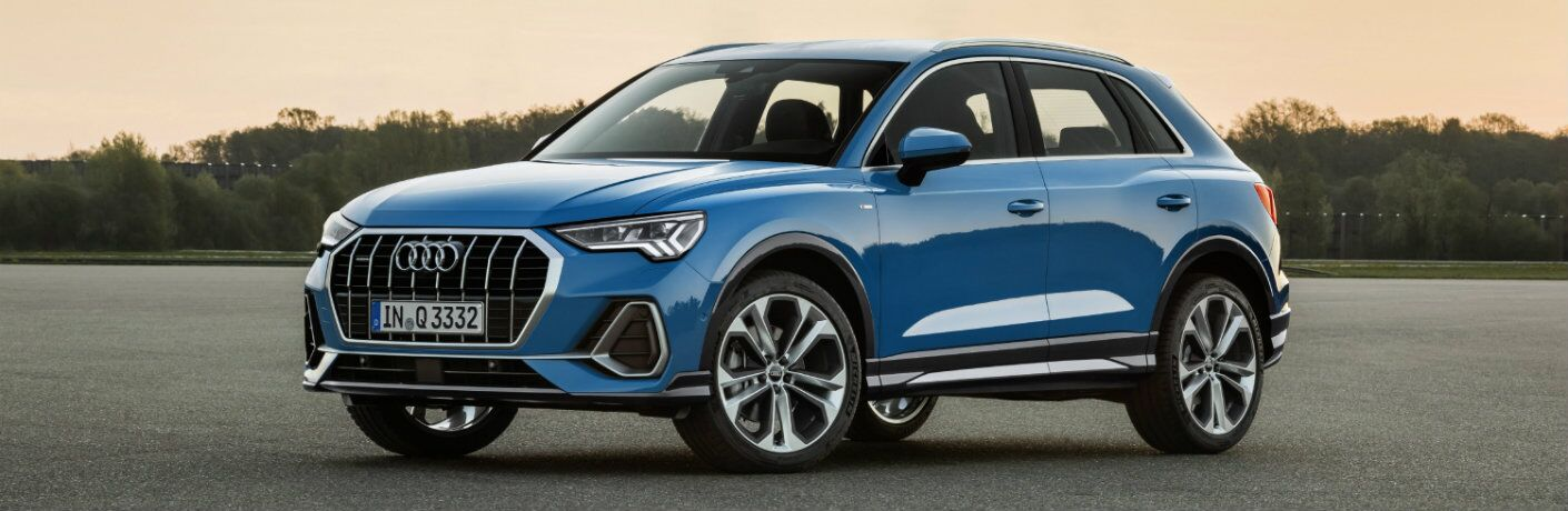 blue 2019 Audi Q3 parked on flat surface at sunset