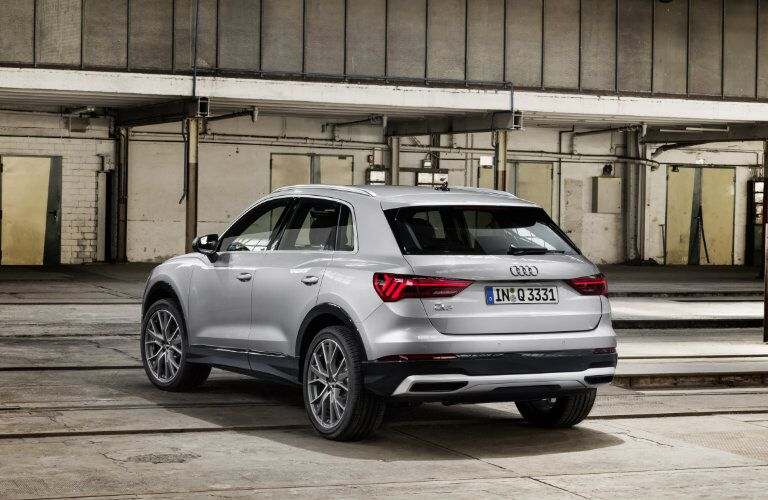 rear view of silver 2019 Audi Q3 parked in warehouse