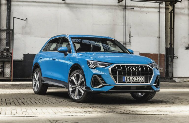 front end view of blue 2019 Audi Q3 parked in garage