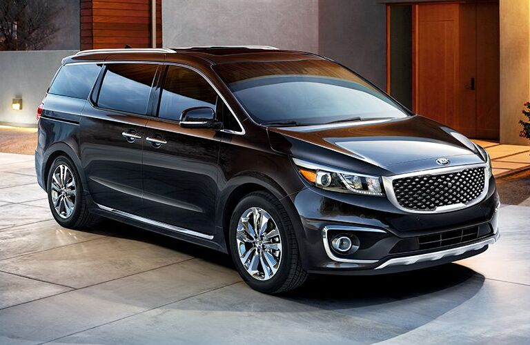 black Kia Sedona parked