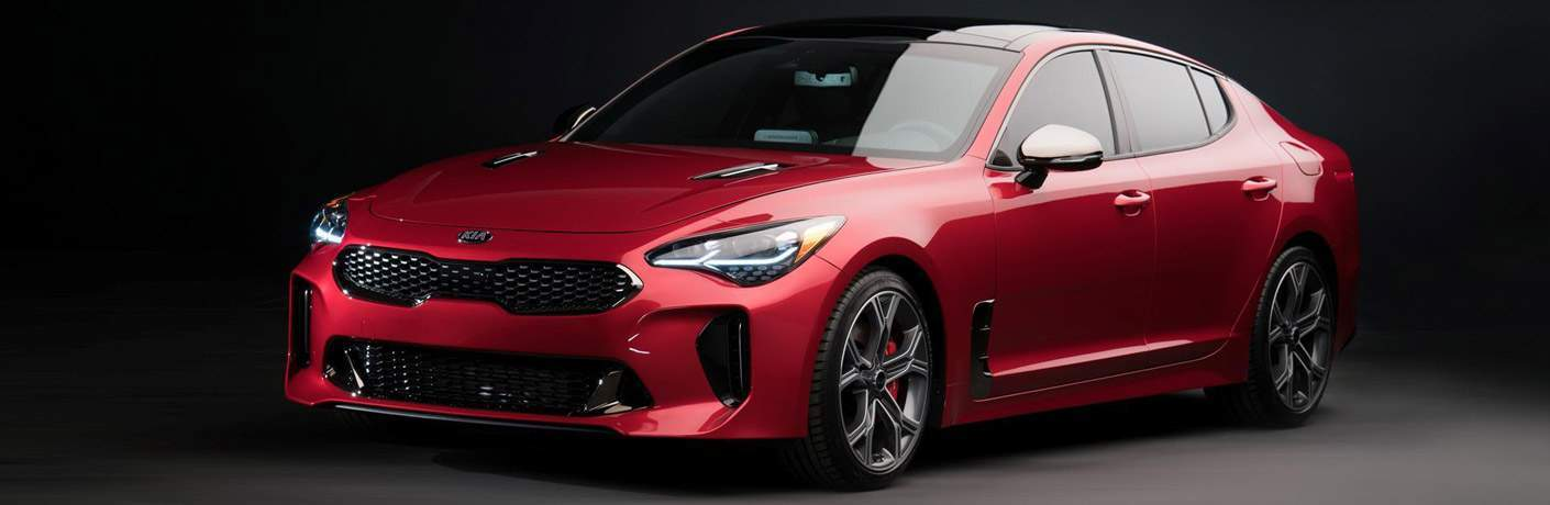 Red 2018 Kia Stinger in front of black background