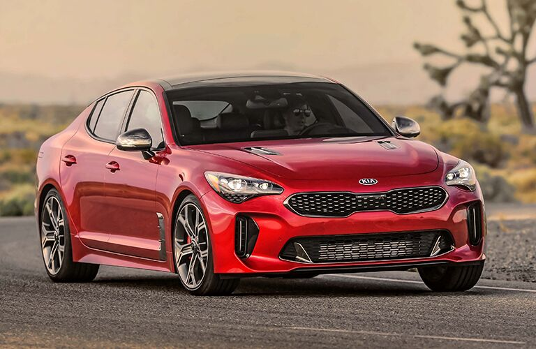 red Kia Stinger driving