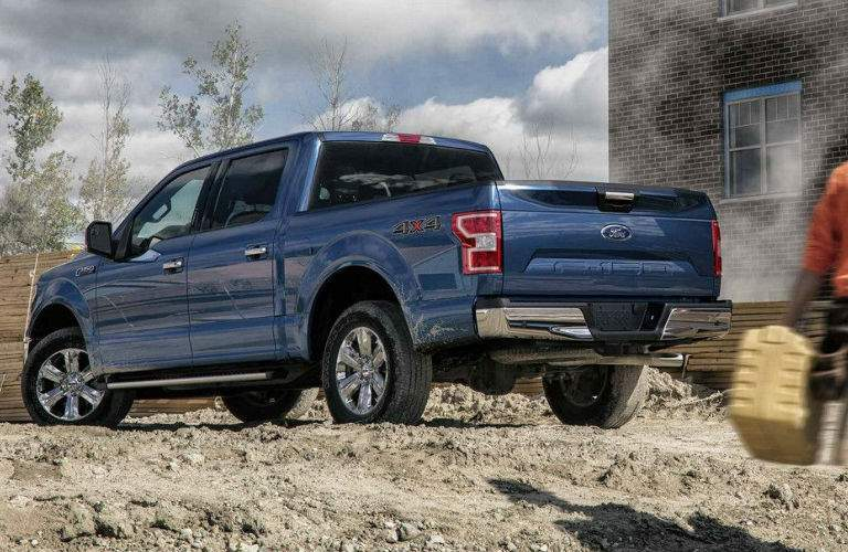 2018 Ford F-150 blue back side view on a construction site