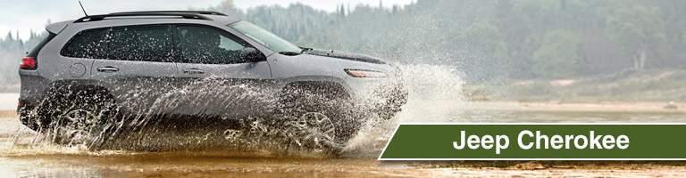 2018 Jeep Cherokee side view splashing through water