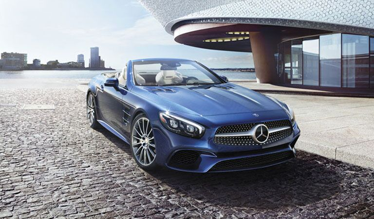 blue 2018 Mercedes-Benz S-Class parked near a futuristic building and a lake