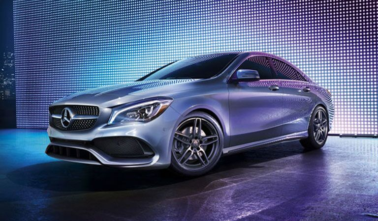 side view of a 2018 Mercedes-Benz CLA with purple lighting