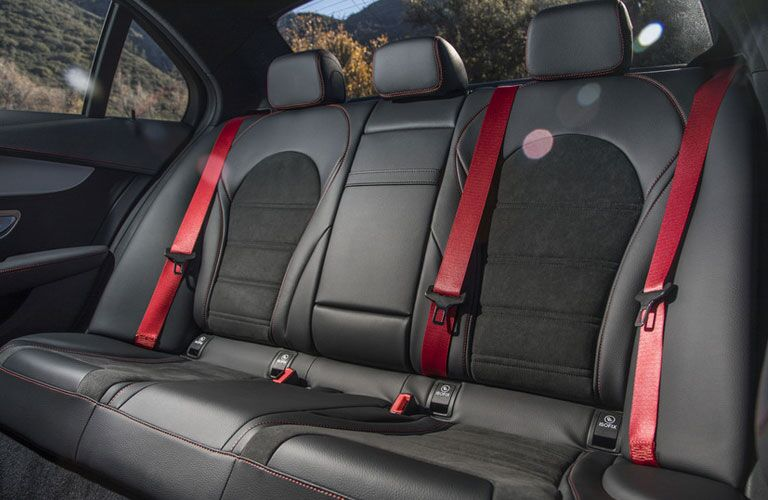 rear seats with red seat belts on AMG version of Mercedes-Benz C-Class