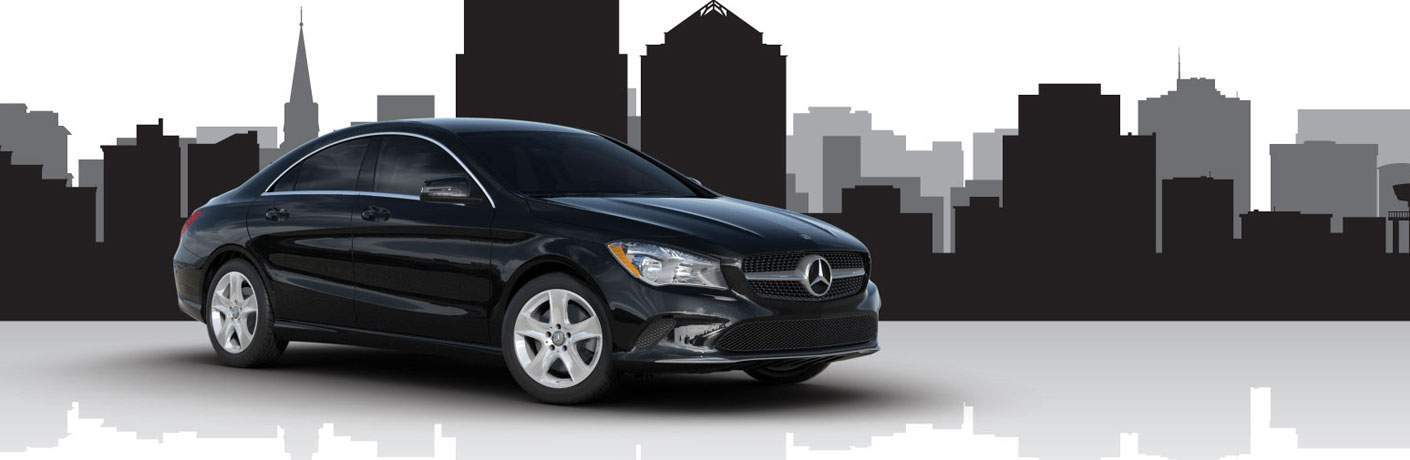 black 2018 Mercedes-Benz CLA in front of city skyline shadow