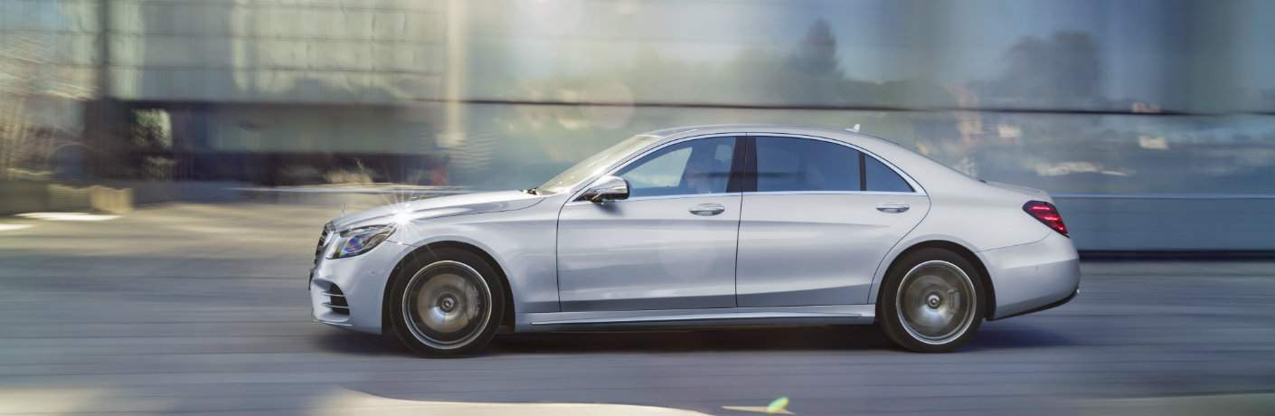 side view of the 2018 Mercedes-Benz S-Class driving in the city