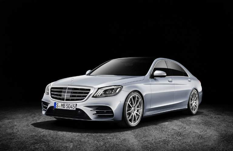 silver 2018 Mercedes-Benz S-Class front and side view with black background