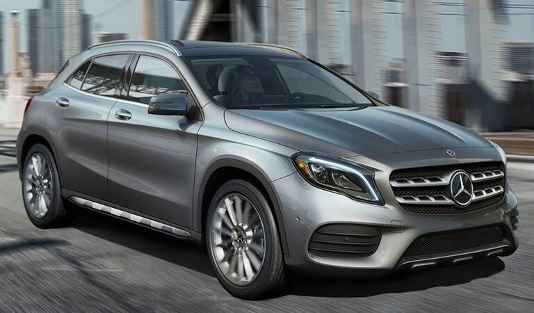 silver 2018 Mercedes-Benz GLA driving over a city bridge