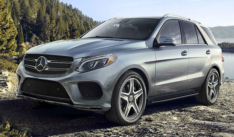 side view of a 2018 Mercedes-Benz GLE parked by a mountain lake
