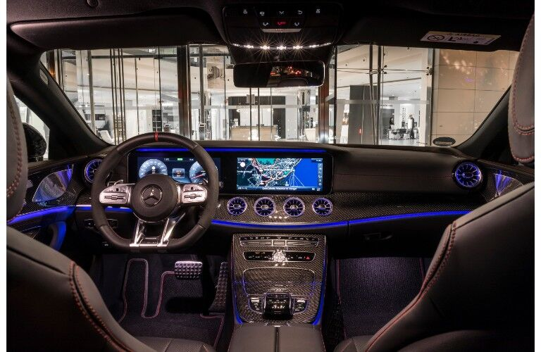 2019 Mercedes-AMG CLS 53  interior shot of front seating, interior ambient lighting, steering wheel, and dashboard
