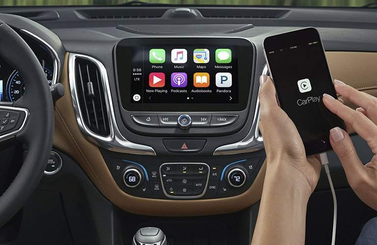 Person using Apple CarPlay in 2018 Chevy Equinox