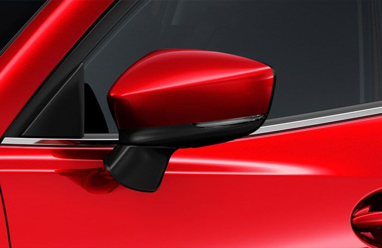 red 2018 Mazda3 side mirror close up