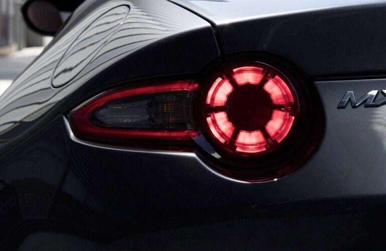 rear taillight of black 2019 Mazda MX-5 Miata