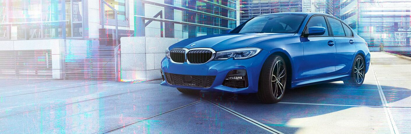 Blue 2019 BMW 3 Series Parked in Front of Modern Glass Building