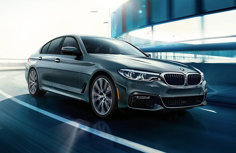 Gray 2019 BMW 5 Series Front and Side Exterior on a Freeway