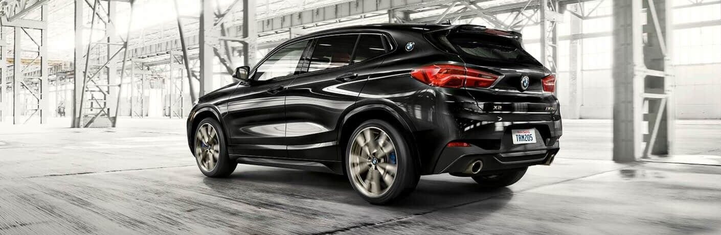 Black 2019 BMW X2 driving through tunnel